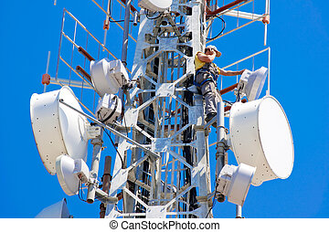 telecom man - Engineer on phone on top of telecom pylon