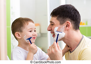 playful father and son shaving together at home bathroom -...