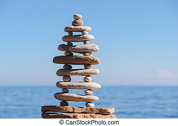 Pyramid of oblong and round pebbles