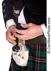 Bagpipes and sporran - Scottish highlander wearing kilt and...