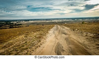 rolled road in a sandy field - landscape of rolled road in a...