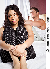 Couple in trouble - A shot of an interracial couple having a...