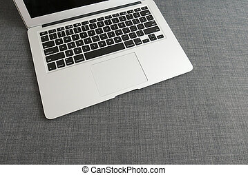 Laptop on the blue cloth background