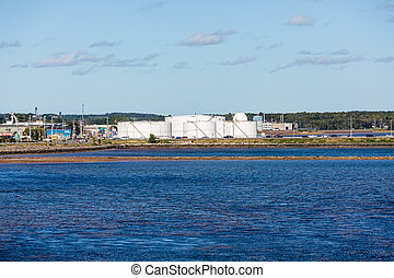 Petroleum Tanks on Blue Shore - An industrial petroleum...