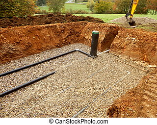 Sand and Gravel Filter Bed - Bottom layer of pipework being...