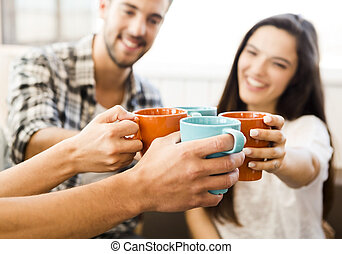 Coffee with friends - Group of friends making a toast with...