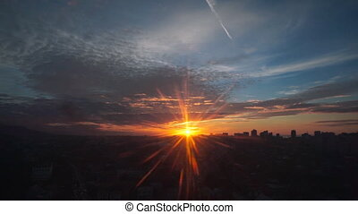 Travel: cityscape view at sunset through glass from moving...