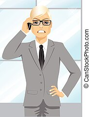 angry businessman talking on mobile phone