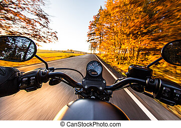 The view over the handlebars of motorcycle - The view over...