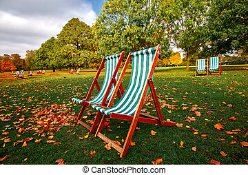 Autumn Park Benches - Autumn in the Park with park bench and...