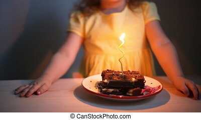 Girl blowing out candles - Little girl blowing out candles,...