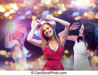 happy women dancing at night club - party, celebration,...