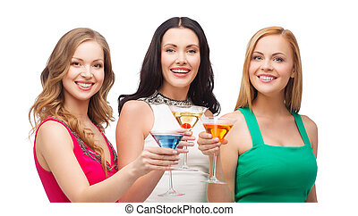 three smiling women with cocktails - party, celebration,...