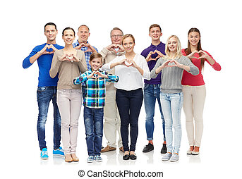 group of smiling people showing heart hand sign - gesture,...