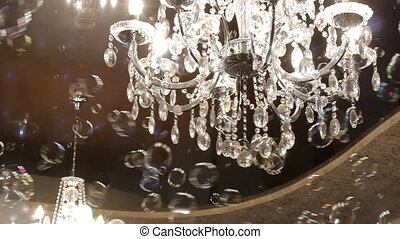 Beautiful hanging crystal chandelier on ceiling.