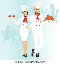 Attractive man and woman chefs with roasted chicken or...