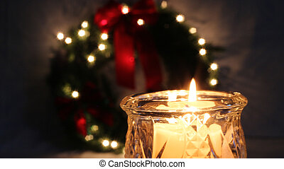 Christmas Bokeh Background - Flickering candle with...