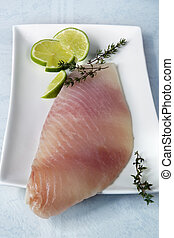 Fish Fillet - Raw fish fillet with lime and thyme, ready for...