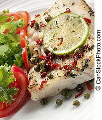 Fish Meal - Grilled white fish fillet with a salad Garnished...