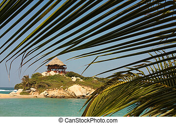 Hut with hammocks on a Caribbean beach. Tayrona National...