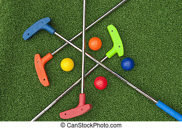 Four Mini Golf Putters and Balls - Four mini golf putters...