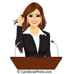 female orator standing behind a podium with microphones....