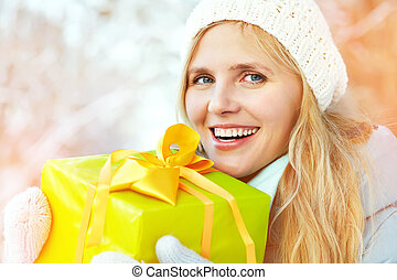 woman with a gift in their hands - Pretty woman with a gift...