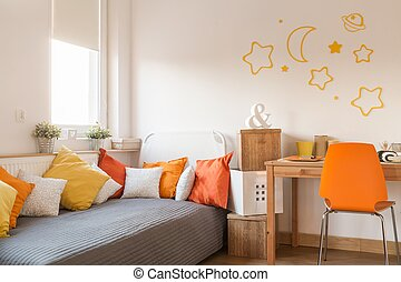 Star wall decor in modern childish room