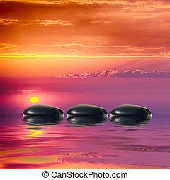 Zen spa concept background-Zen black massage stones reflected in water