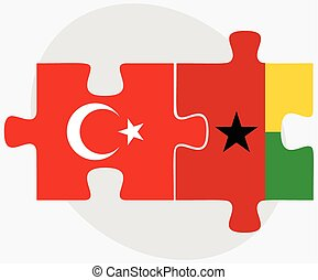Turkey and Guinea-Bissau Flags in puzzle isolated on white...