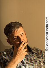 Male puffing on a cigarette - Picture of male brunet puffing...