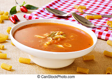 minestrone, typical italian soup - closeup of a bowl with...