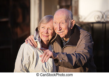 Man Pointing with Girlfriend - Handsome senior man pointing...