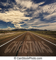 Road With the Word Christmas - Conceptual image of desert...