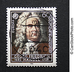 Vintage German postage stamp with image of the composer...