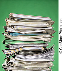 Finance documents on green background