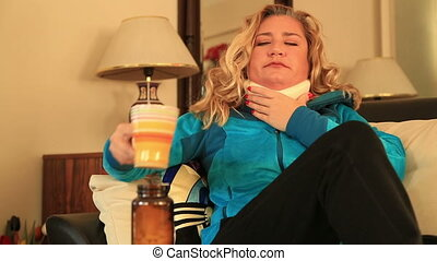 Painful woman with neck brace
