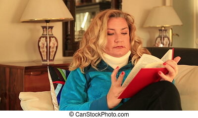 Painful woman with neck brace reading a book