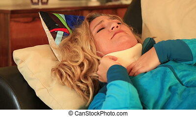 Painful woman with neck brace trying to sleep