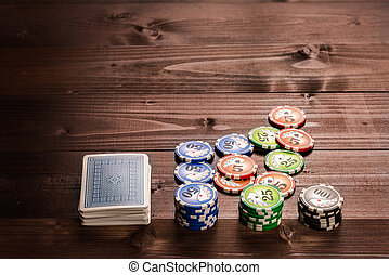 Chips and cards - old vintage cards and a gambling chip on a...