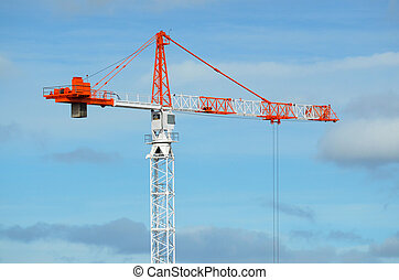 Tower crane - Profile of a red and white Tower crane against...