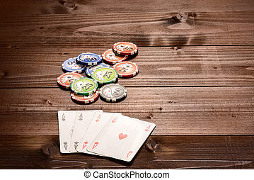 Four aces and chips, vintage poker game playing cards on a...
