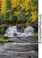 Autumn at Power House Falls - Colorful fall foliage tops...