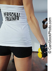 fitness woman personal trainer in sport club indoor