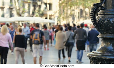 Crowded Barcelona City Center - People crowd crossing a...