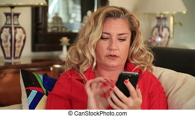 Woman using smart phone - Blonde woman using smartphone on...