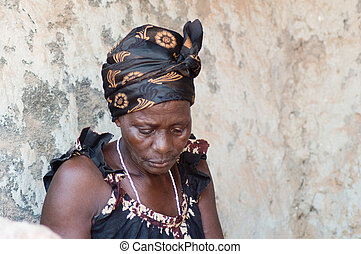 African woman in the village. - This woman is dressed like...