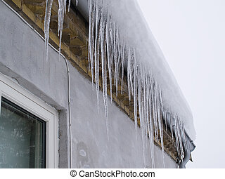 Icicles on a roof winter background image
