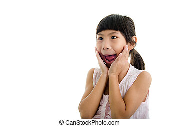 Cute little girl in pink making funny face with copyspace.