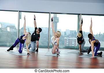 fitness group - young healthy people group exercise fitness...
